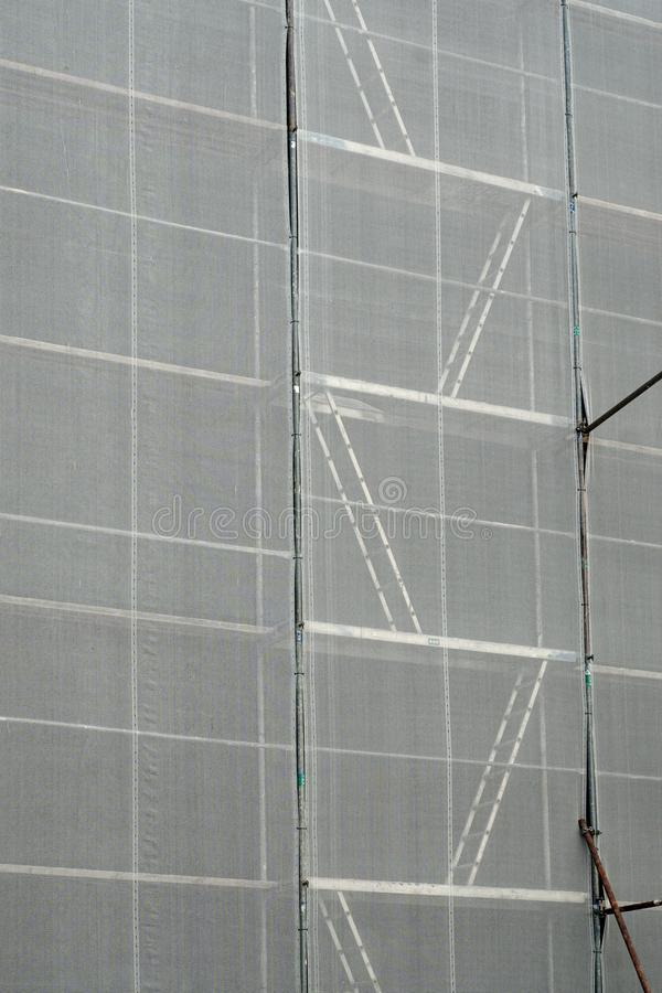 Free Scaffolding. Scaffold Covered With A White Canvas For Protection Royalty Free Stock Photos - 120066038