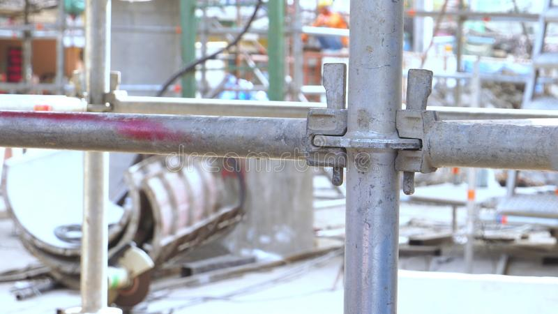 Scaffolding steel pipe fitting CLAMP at construction site, close up photo stock image