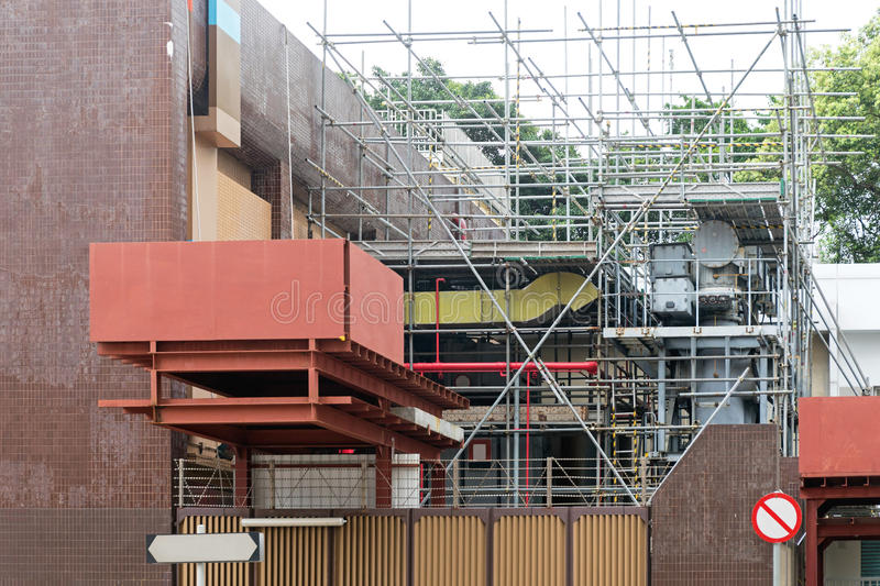 Scaffolding Utility. Scaffoldings and Construction Platform at Utility Building stock image