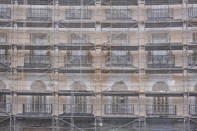 Scaffolds on an antique building. Restoration works. Architecture, construction. Background royalty free stock photo