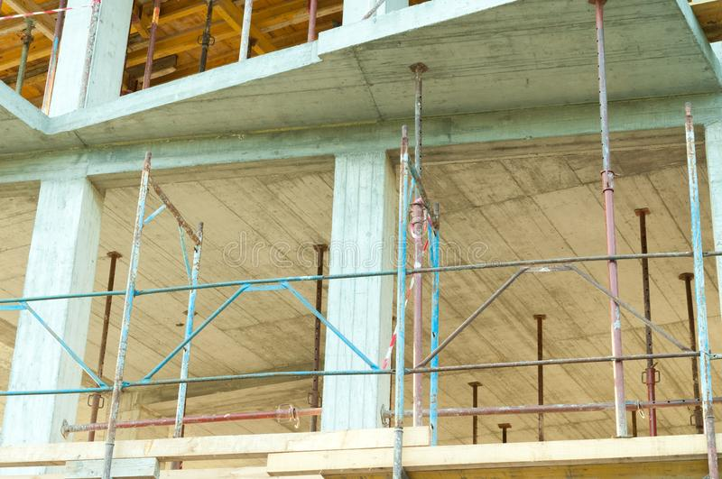 Scaffolds on the new building construction site closeup. stock photography