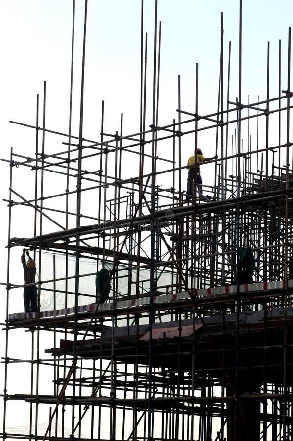 scaffoldsarbetare arkivfoto