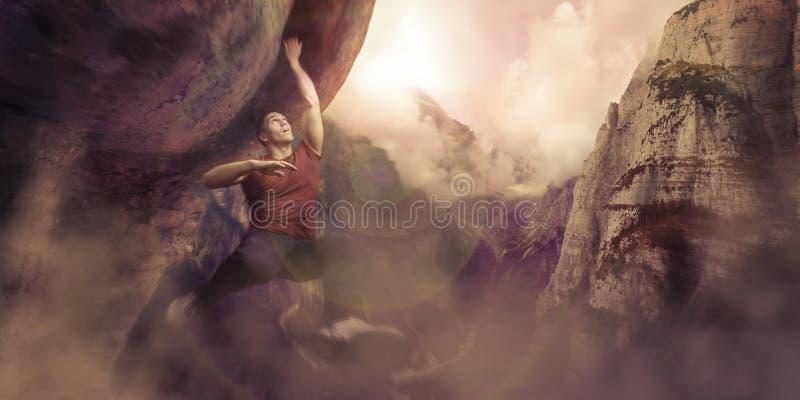 Scalatore di montagna che appende su una scogliera su una montagna fotografie stock