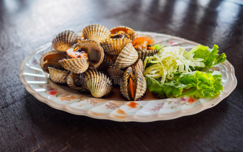 Scald scallops, cockles shell, at Thai restaurant. Scald scallops or boiled cockles shell, at Thai restaurant stock photo