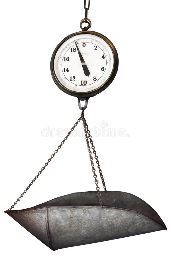 Scale. A large antique scale with metalic tin scoop stock photography