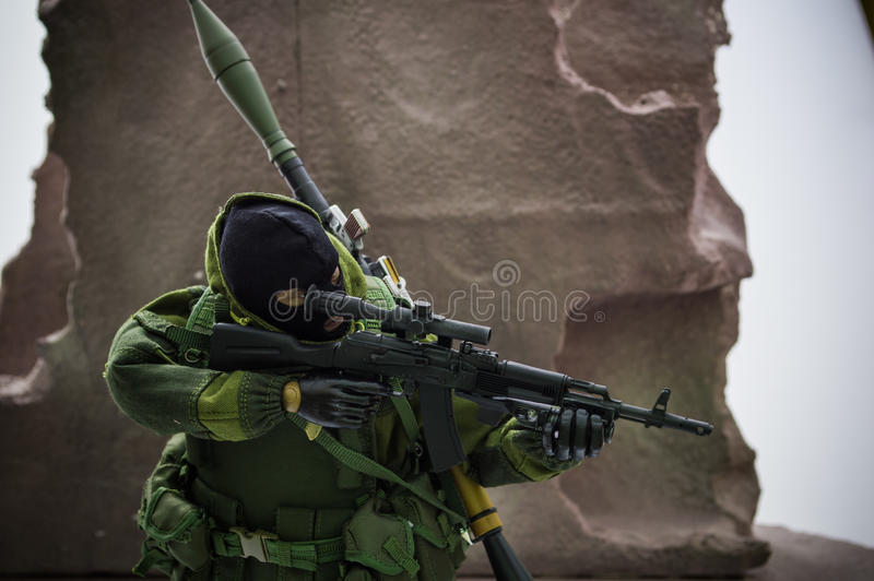 Toy man 1/6 scale action figure army miniature realistic background stock images