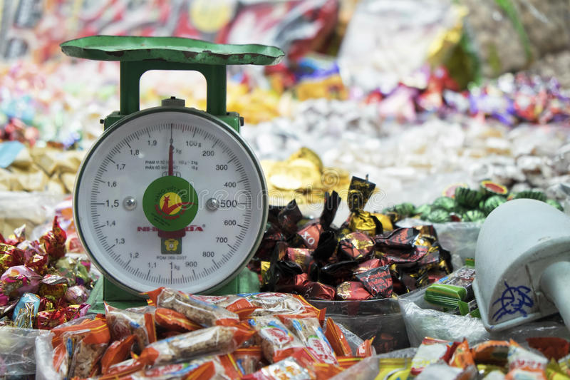 Scale and Candy, Chinatown Market, Vietnam royalty free stock photography