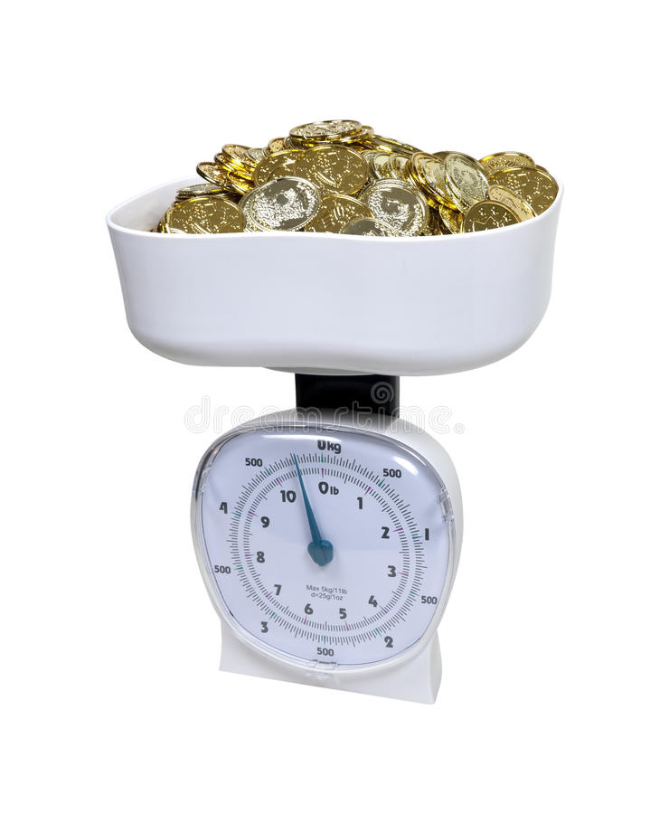 Scale full of Gold Coins royalty free stock photos