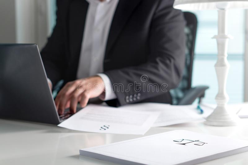 Scale and justice sign on pile of paper. royalty free stock photos