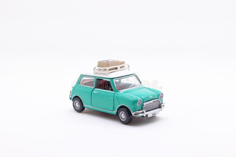 A scale of Mini Coopers of toy display. The scale of Mini Coopers of toy display royalty free stock photo