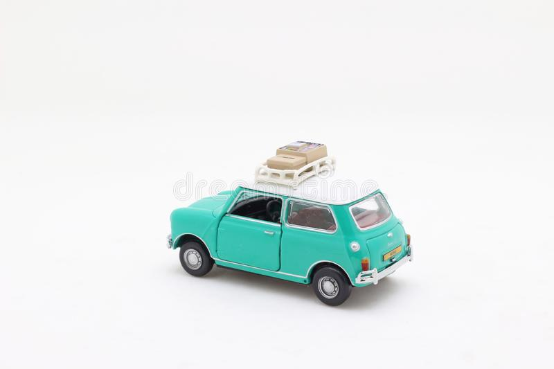 A scale of Mini Coopers of toy display. The scale of Mini Coopers of toy display royalty free stock image
