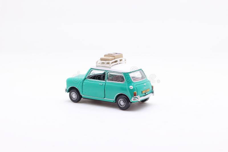 A scale of Mini Coopers of toy display. The scale of Mini Coopers of toy display stock photography