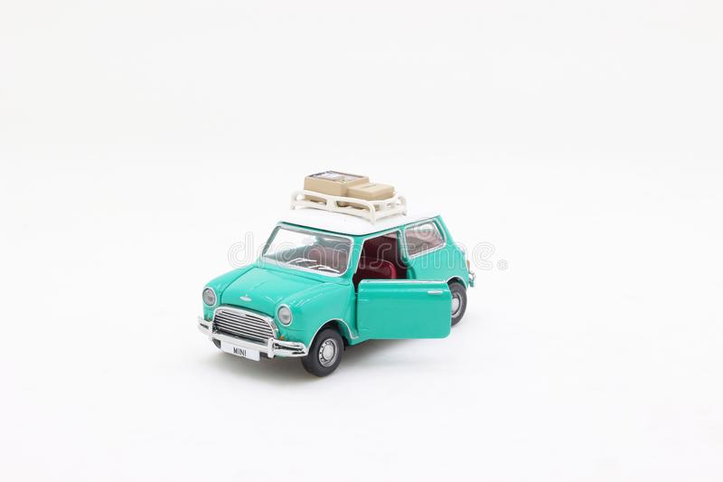 A scale of Mini Coopers of toy display. The scale of Mini Coopers of toy display stock photos
