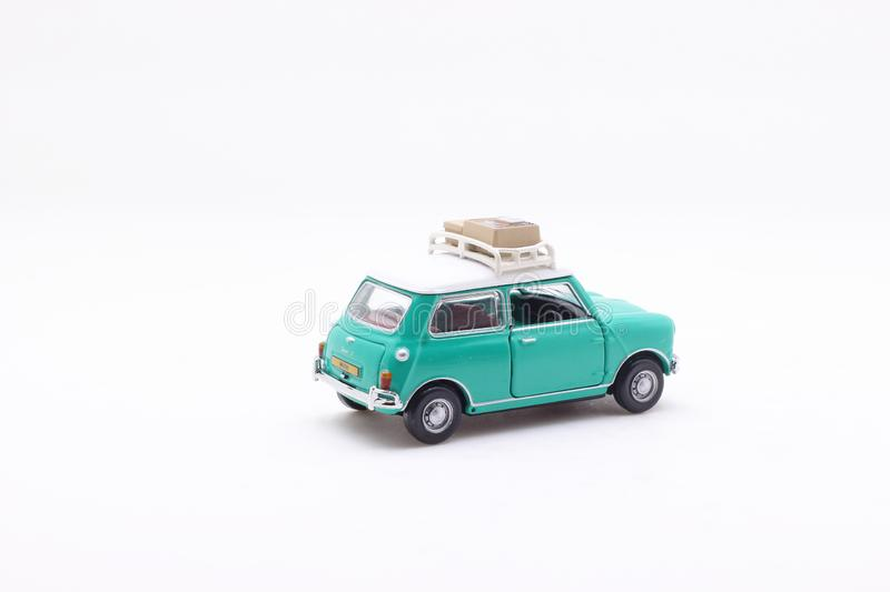 A scale of Mini Coopers of toy display. The scale of Mini Coopers of toy display royalty free stock photography