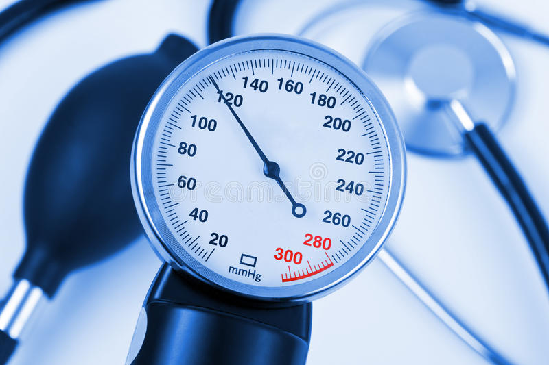Scale of pressure and stethoscope royalty free stock photos