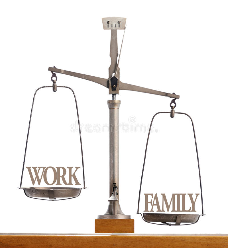 Scale showing the balance of work and family royalty free stock images