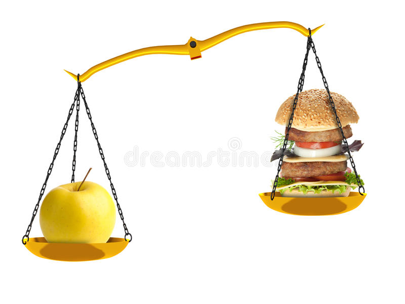 Scales with an apple and a hamburger stock photos