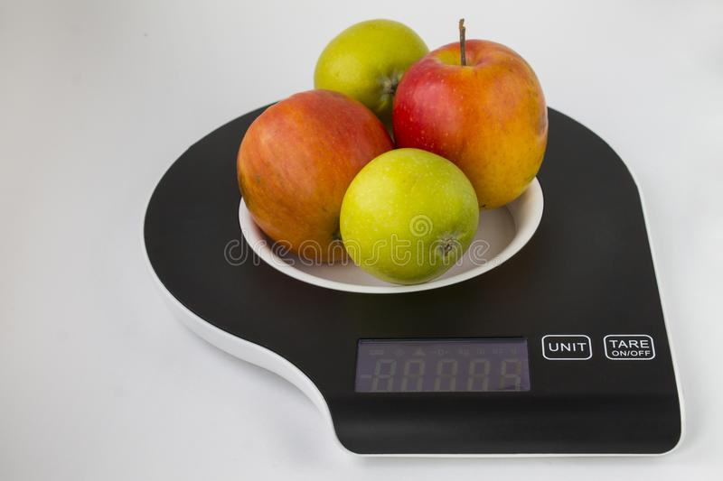 Scales and apples royalty free stock photos