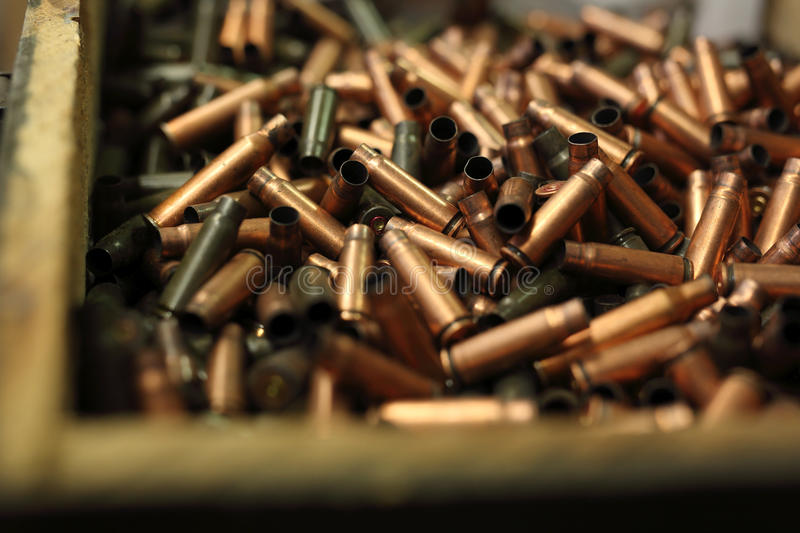 The scales on the cartridges. Ammunition, brass scales on the cartridges stock photography