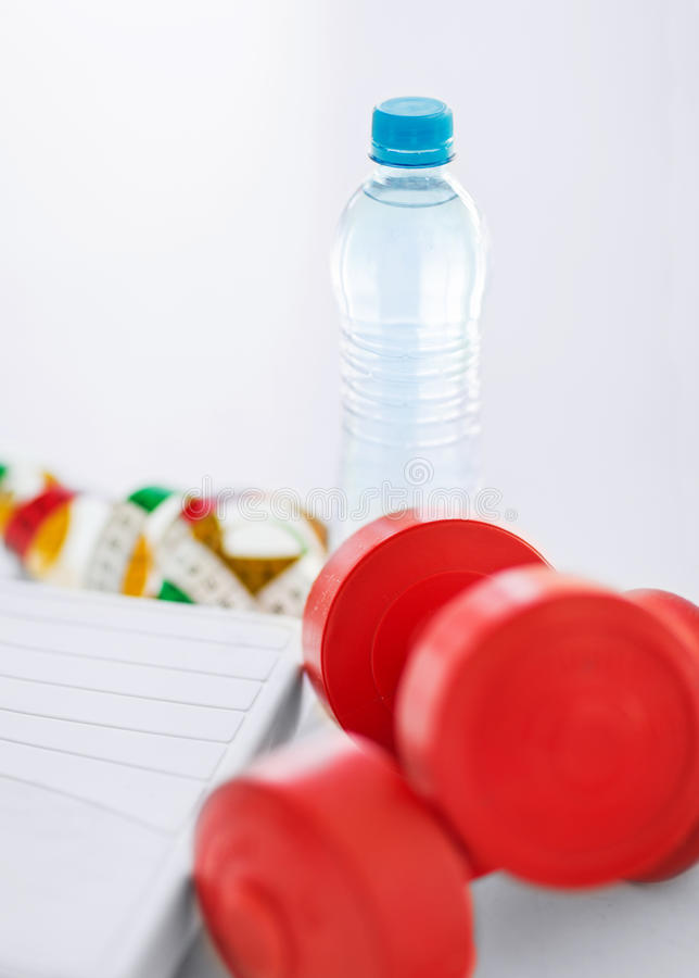 Download Scales, Dumbbells, Bottle Of Water, Measuring Tape Stock Photo - Image: 33188228
