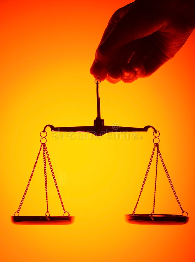 Scales in hand. Scales on orange light background