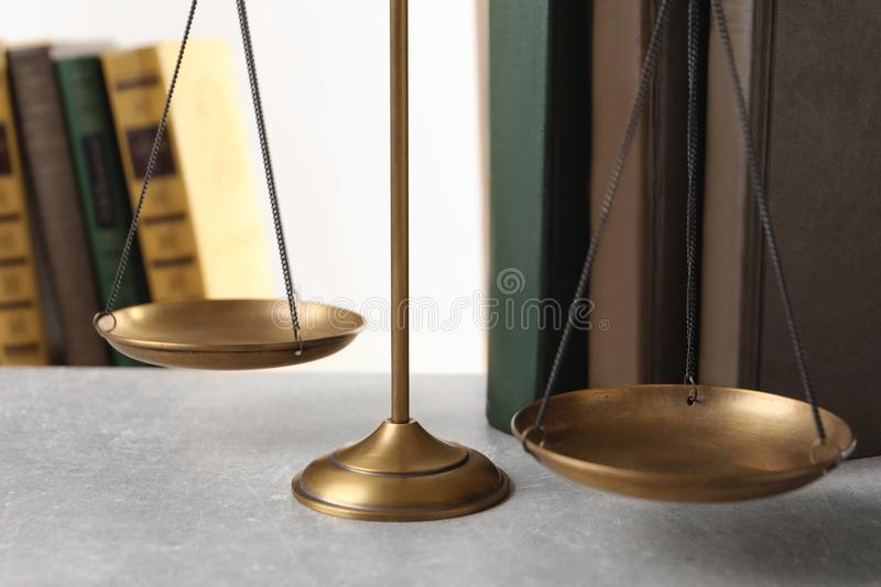 Scales of justice and books on table, closeup. Law concept royalty free stock images