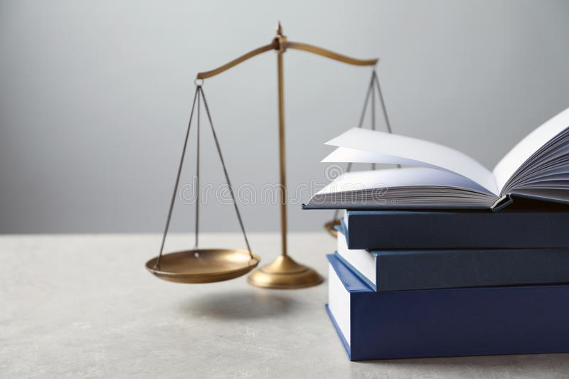 Scales of justice and books on table. Law concept royalty free stock photo