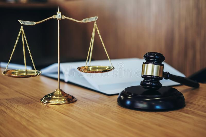 Scales of justice and Gavel on sounding block and law book to working with judge agreement in Courtroom, Justice and Law concept.  royalty free stock images