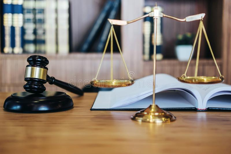 Scales of justice and Gavel on sounding block and law book to working with judge agreement in Courtroom, Justice and Law concept.  royalty free stock photo