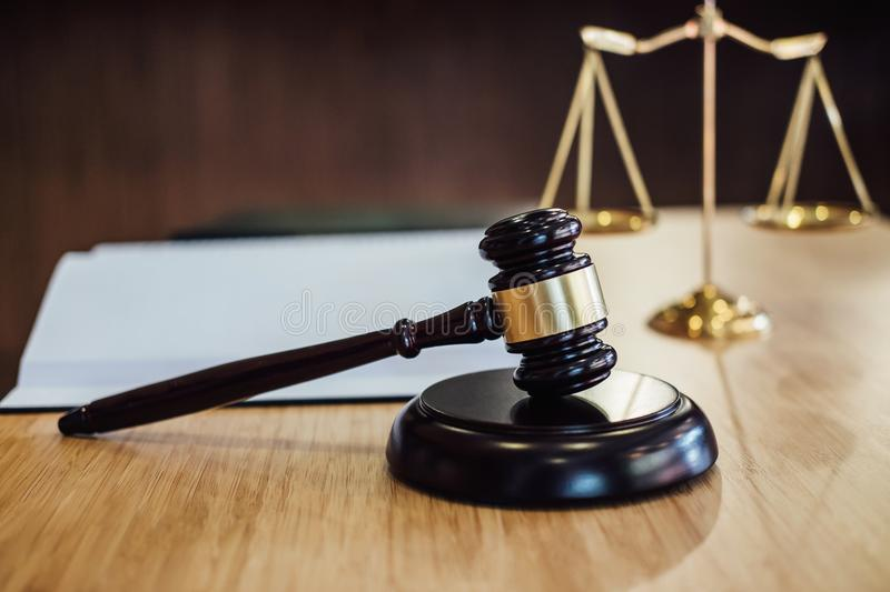 Scales of justice and Gavel on sounding block and law book to working with judge agreement in Courtroom, Justice and Law concept.  stock photos
