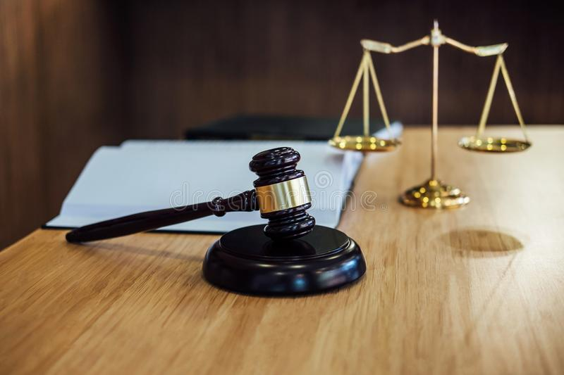 Scales of justice and Gavel on sounding block and law book to working with judge agreement in Courtroom, Justice and Law concept.  royalty free stock photos