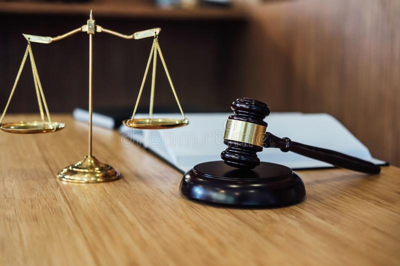 Scales of justice and Gavel on sounding block and law book to working with judge agreement in Courtroom, Justice and Law concept.  stock photography