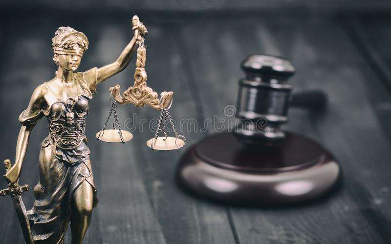 Scales of Justice, Judge Gavel, Justitia, Lady Justice on a black wooden background royalty free stock photography
