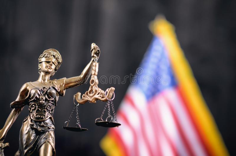 Scales of Justice, Justitia, Lady Justice in front of the American flag in the background stock photography