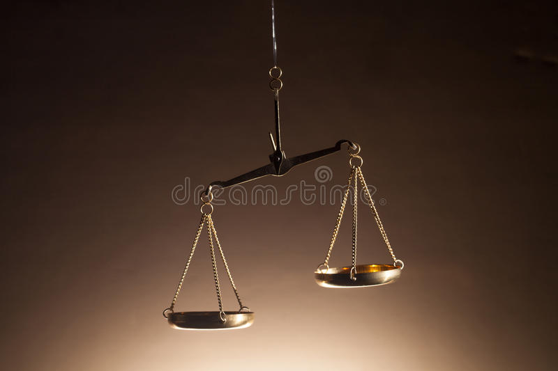 Scales of Justice. Set of gold scales representing the scales of justice. Ideal for legal websites and publications stock photography