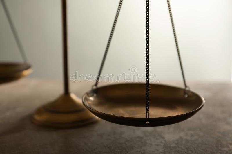 Scales of justice on table, closeup. Law concept royalty free stock photo