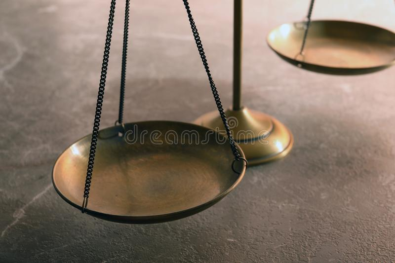 Scales of justice on table, closeup. Law concept stock images