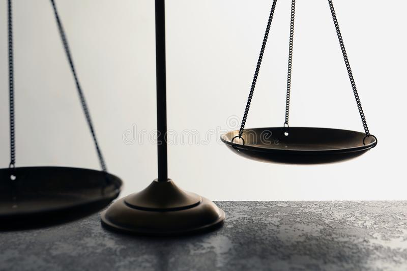 Scales of justice on table, closeup. Law concept stock photography
