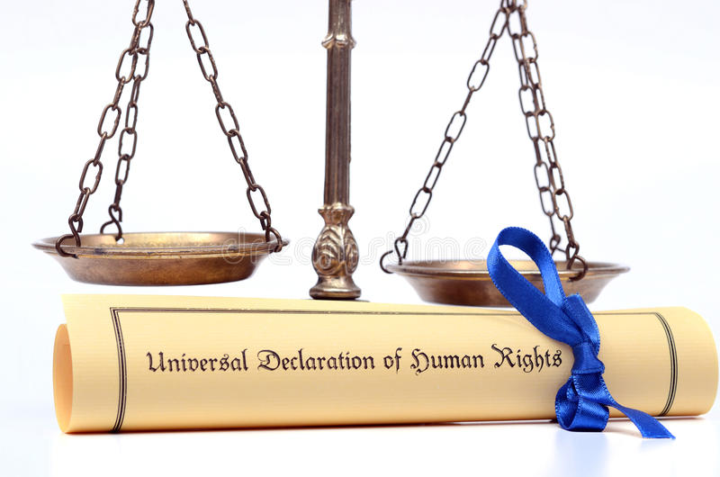 Scales of justice and The Universal Declaration of Human Rights. Scales of justice and The Universal Declaration of Human Rights, Human rights concept, isolated royalty free stock photo