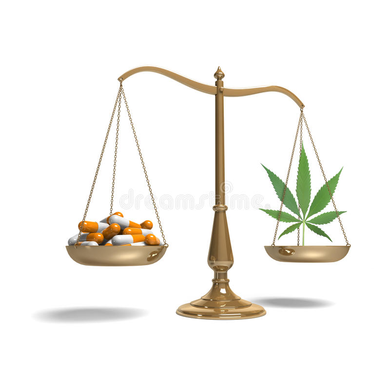 Scales with pills and marijuana royalty free stock photography