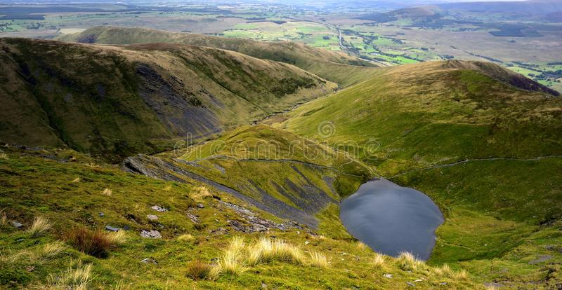 Scales Tarn from Blencathra. Foopath to Sharp Edge from Scales Tarn royalty free stock image