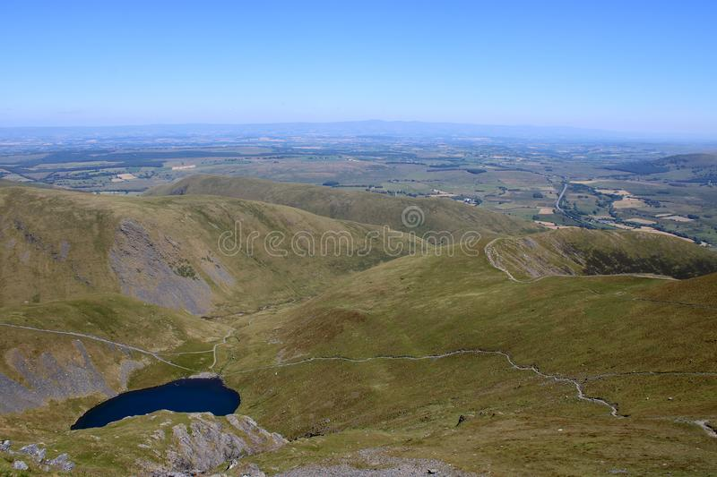 Scales Tarn and Fell, Blencathra, distant Pennines. Looking east from upper slopes of Blencathra aka Saddleback in the English Lake district, Cumbria, UK, to royalty free stock images