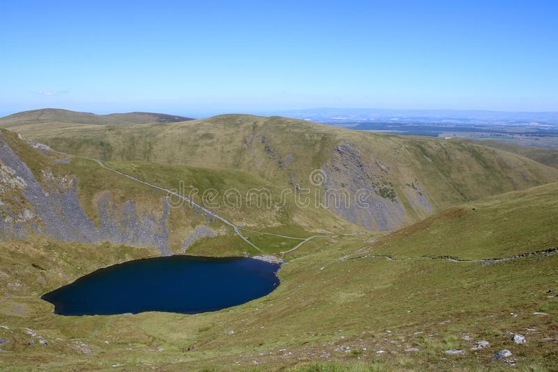 Scales Tarn and view north east from Blencathra. View down to Scales Tarn from slopes of Blencathra also known as Saddleback in the English Lake district stock photo