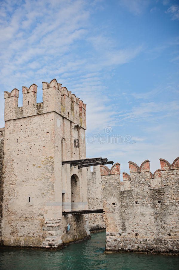 Scaligers castle on Garda lake, Sirmione, Italy. In sunny summer day stock photography