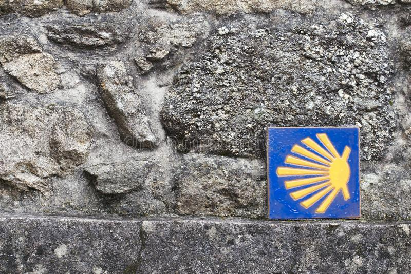 Scallop shell, symbol of the Camino de Santiago. In a wall in Galicia Spain royalty free stock photography