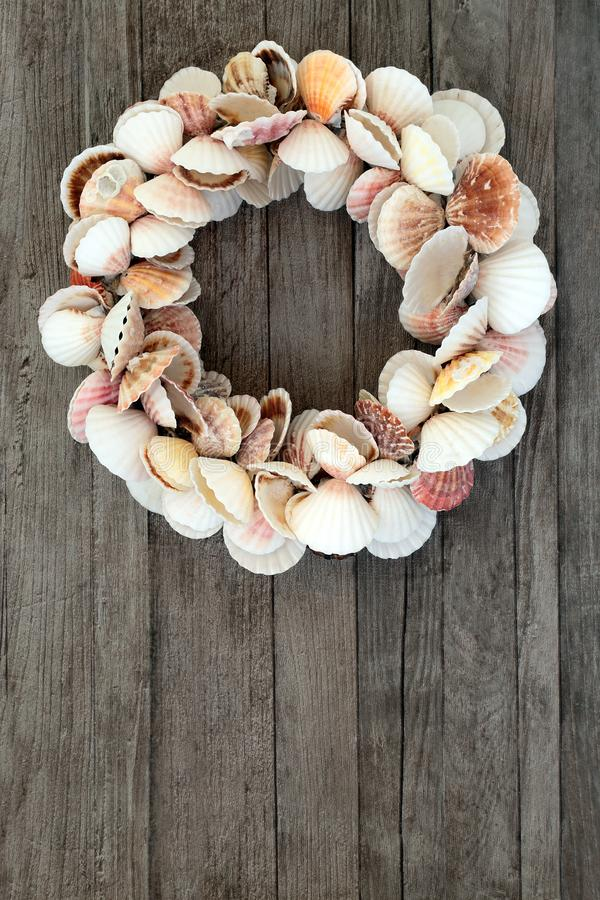 Scallop Shell Wreath ion Rustic Wood royalty free stock photography
