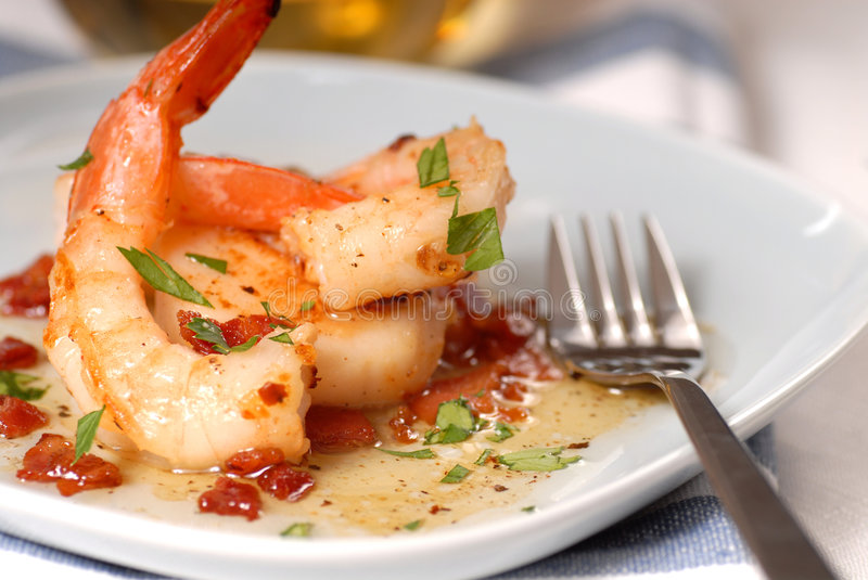 Scallop and shrimp sauteed in a bacon vinniagrette royalty free stock photography
