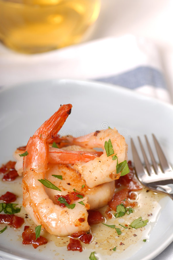 Scallop and shrimp sauteed in a bacon vinniagrette stock photography