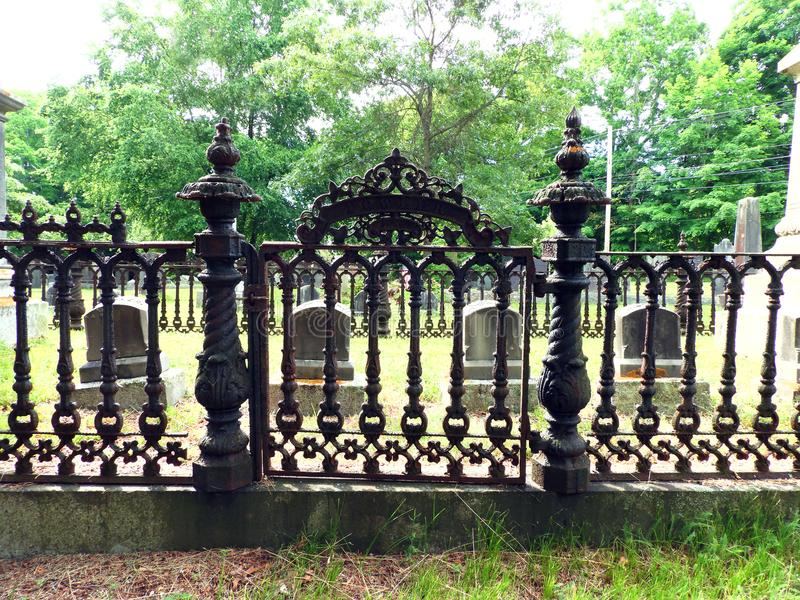 Scalloped picket cast iron gate and fence in cemetery royalty free stock image
