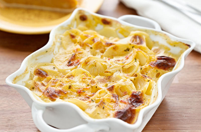 Scalloped potatoes. Photo of a casserole dish filled with freshly baked scalloped potatoes stock photos